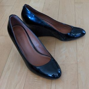 Coach Shoes - Coach Black Wedge Pumps size 8